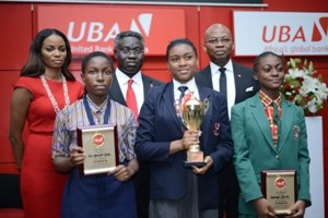 Managing Director, UBA Foundation, Ms. Ijeoma Aso, GMD/CEO, UBA Plc, Mr. Phillips Oduoza and DMD, UBA Plc, Mr. Kennedy Uzoka with the winners of 2015 UBA Foundation National Essay Competition- 1st prize winner Miss Emediong Uduak Uko of British Nigerian Academy, Abuja (middle) ;  2nd prize winner Miss Enonuoya Starish of Lagoon School Lagos (right); and 3rd prize winner Miss Eze Ugochinyere Golden of Living World Academy Aba, during the grand finale and prize giving ceremony held at UBA House in Lagos on Monday.